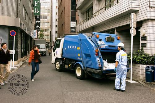 Garbage man and truck, at an alley in Shinjuku