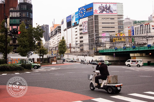 Shinjuku Street, man on three wheel bike