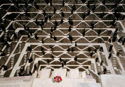 The Fall's character Charles Darwin at the Chand Baori, one of the deepest and largest step wells in India located in a village near Jaipur, Rajasthan