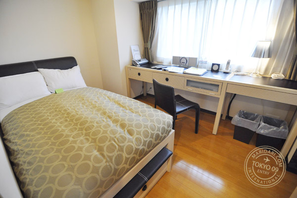 Semi double bed in bedroom of B-SITE Akihabara Tokyo Apartment