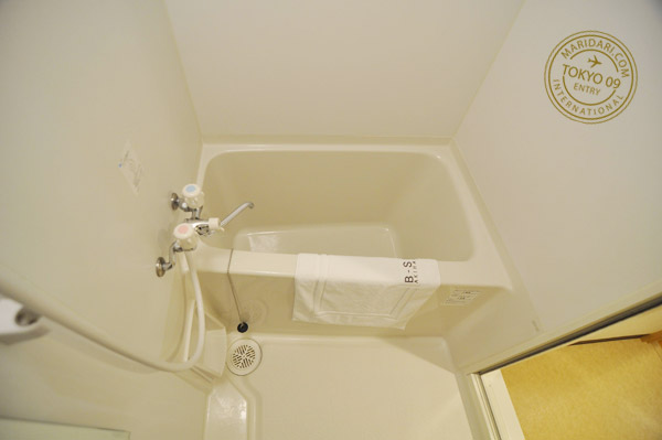 Small bathtub in bathroom of B-SITE Akihabara Tokyo Apartment