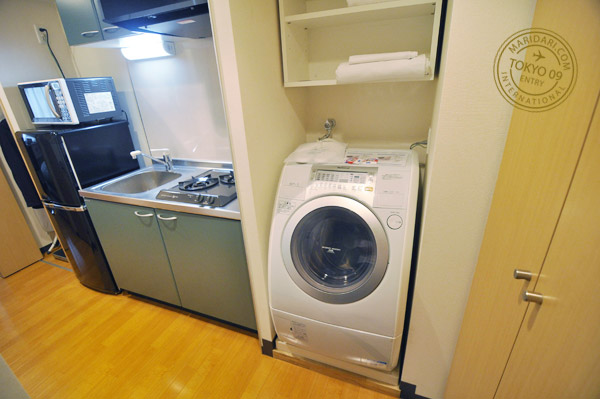 B-SITE Akihabara Tokyo Apartment review and images - photo of washing machine and dryer, stove and refrigerator