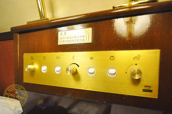 Evergreen Hotel Hong Kong bed-side controls - switches on and off the television and lights