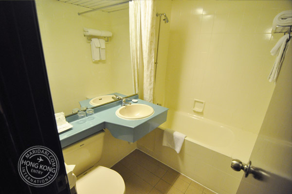 Evergreen Hotel Hong Kong bathroom - clean bath tub, sink, counter top and toilet bowl