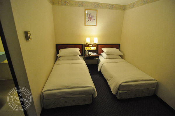 Evergreen hotel hong kong review and images for Small room two twin beds